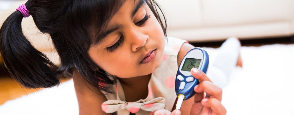 child playing with thermometer